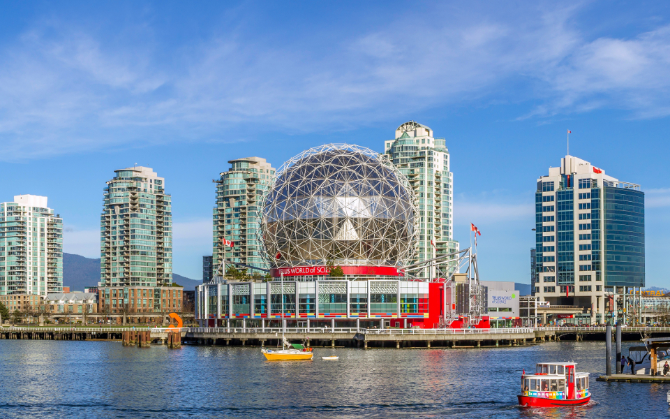 A scene of beautiful False Creek, featuring Science World and the Main Street Skytrain station